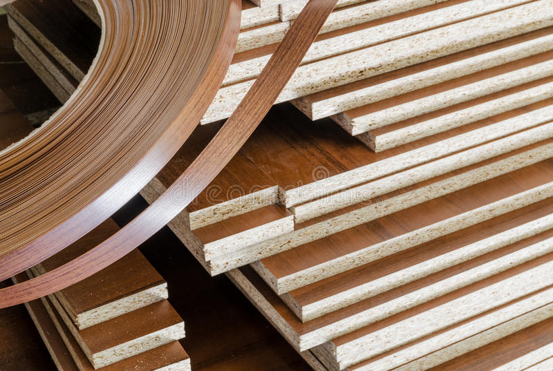 Board chipboard cut parts. For furniture production close-up stock images