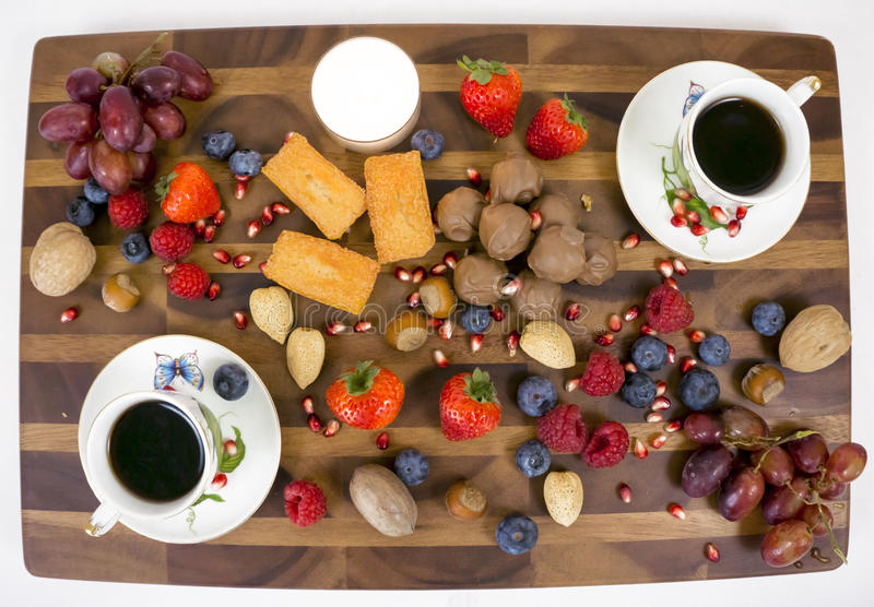 Board with coffee and dessert. stock image