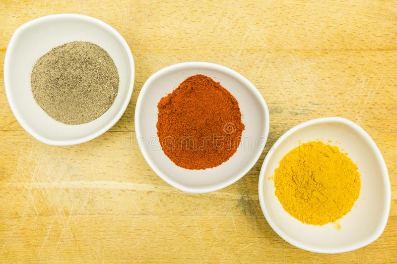 Board with colorful spices in bowls. View from above. royalty free stock photo