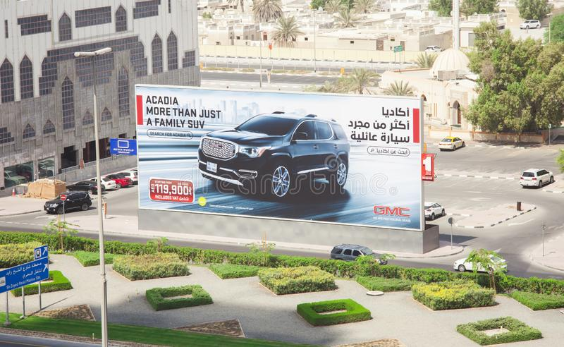 Board commercial of GMC suv car, 4x4 new vehicle for sale. DUBAI, UAE - SEPTEMBER 25 2018: board commercial of GMC suv car, 4x4 new vehicle for sale royalty free stock photography