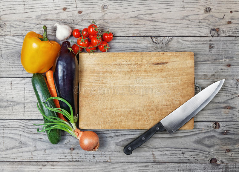Board cooking ingredient knife. Close up board cooking wood more vegetable ingredient royalty free stock photos