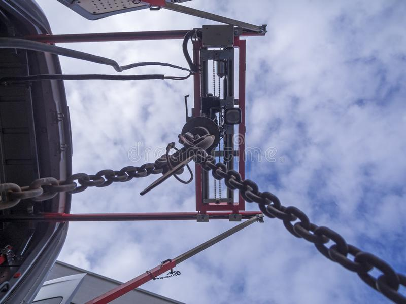 On-board crane in lower view. Soffit vertically upwards on an extended on-board crane of a transport vehicle of the Berliner Stadtwerke against cloudy sky royalty free stock photos