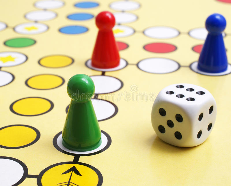 Board game and dice stock images