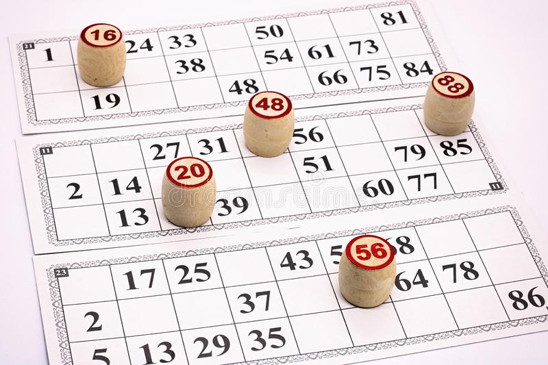 Board game lotto, cards with numbers for the game, kegs are on the cards during the game,. Game stock images