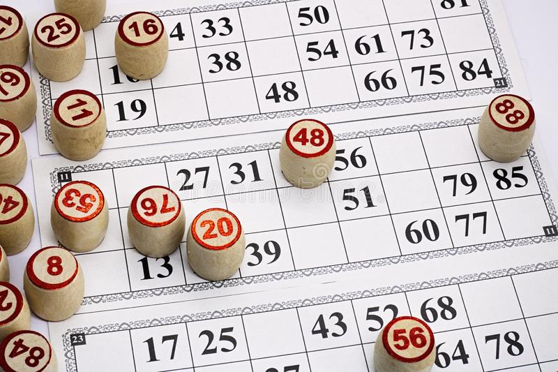 Board game lotto, cards with numbers for the game, kegs are on the cards during the game,. Game stock photos