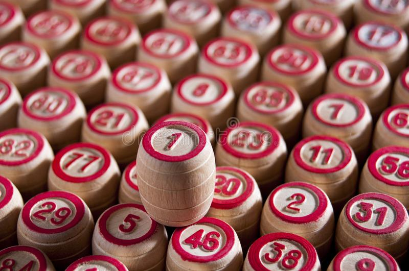 Board game lotto. Wooden barrels with lotto for the game of lotto are in even rows. Upstairs is a barrel with the number one. Victory. Group entertainment royalty free stock photos
