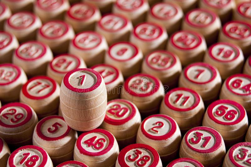 Board game lotto. Wooden barrels with lotto for the game of lotto are in even rows. Upstairs left is a barrel with the number one. Victory. Group entertainment stock photos