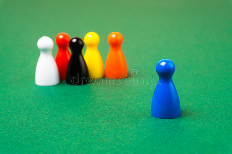 Board game pawns with one in a lead stock photography