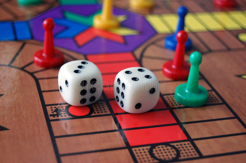 Board Game Sorry. The board game sorry with coloured pieces and dice stock photography