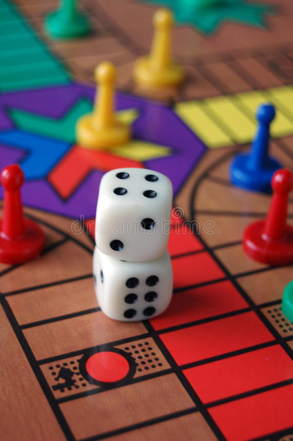 Board Game Sorry. The board game sorry with coloured pieces and dice royalty free stock photography