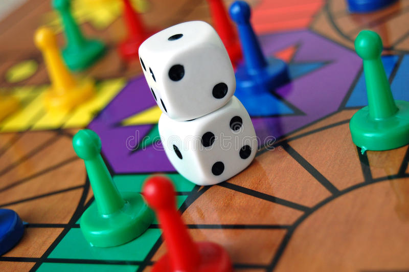 Board Game Sorry. The board game sorry with coloured pieces and dice stock images