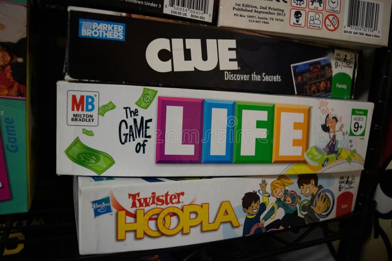 Board games by some of the biggest board game companies. 3 Board games from my youth, Clue, The Game of Life and Twister Hoopla, produced by 3 different board stock image