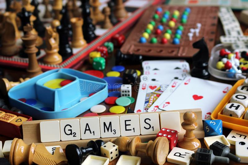 Board Games. Various traditional games on a table stock photo