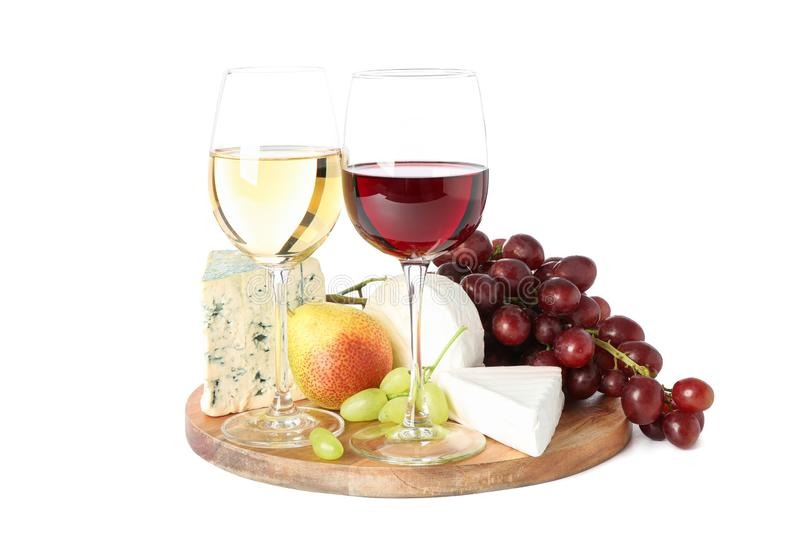 Board, glasses with wine, cheese and fruits isolated on white stock images
