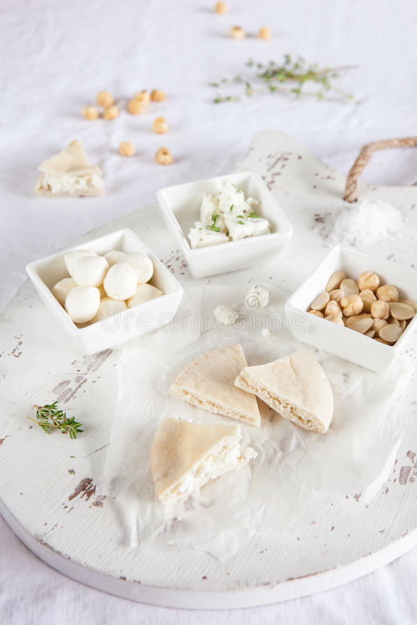 Download Board with pita and cheese stock photo. Image of bowls - 28104116