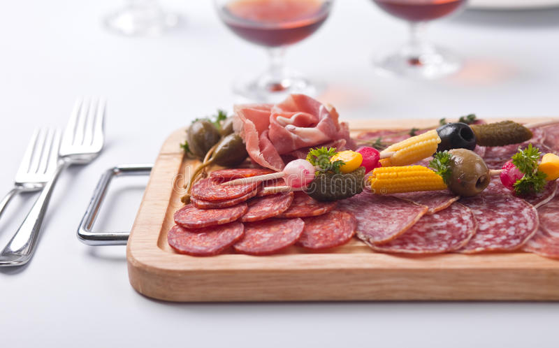 Board at restaurant with meat and sausage stock photo