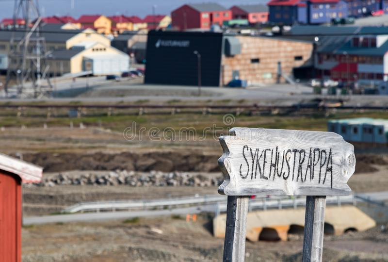 Board sign with the word Sykehustrappa which means hospital stairs in Longyearbyen, Svalbard. Longyearbyen, Svalbard, Norway - August 13th, 2018: Wooden board royalty free stock photos