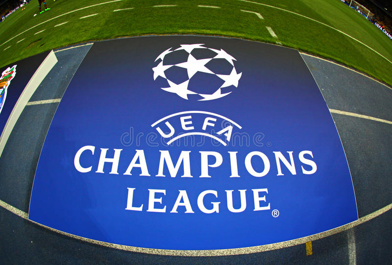 Board with UEFA Champions League Logo on the ground. KYIV, UKRAINE - SEPTEMBER 16, 2015: Board with UEFA Champions League Logo on the grass before the game royalty free stock photo