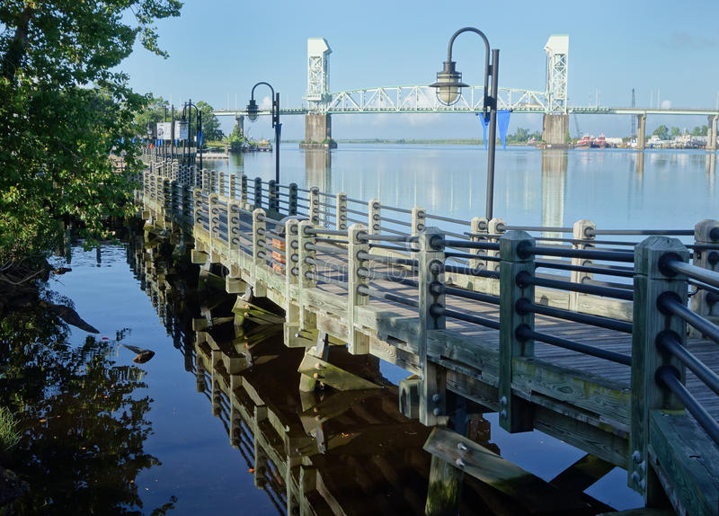 Board walk along Cape Fear river and bridge view. stock photo
