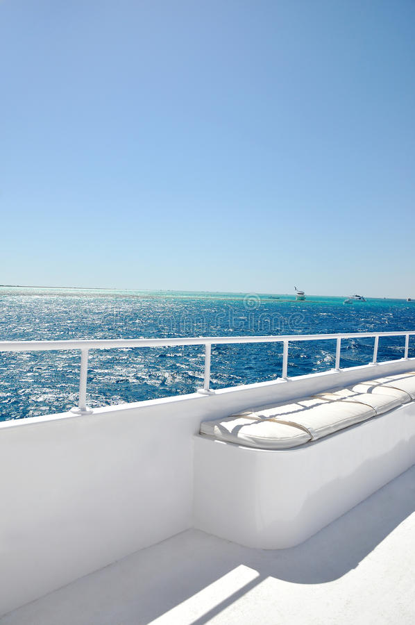 On a board of white luxury yacht royalty free stock photography