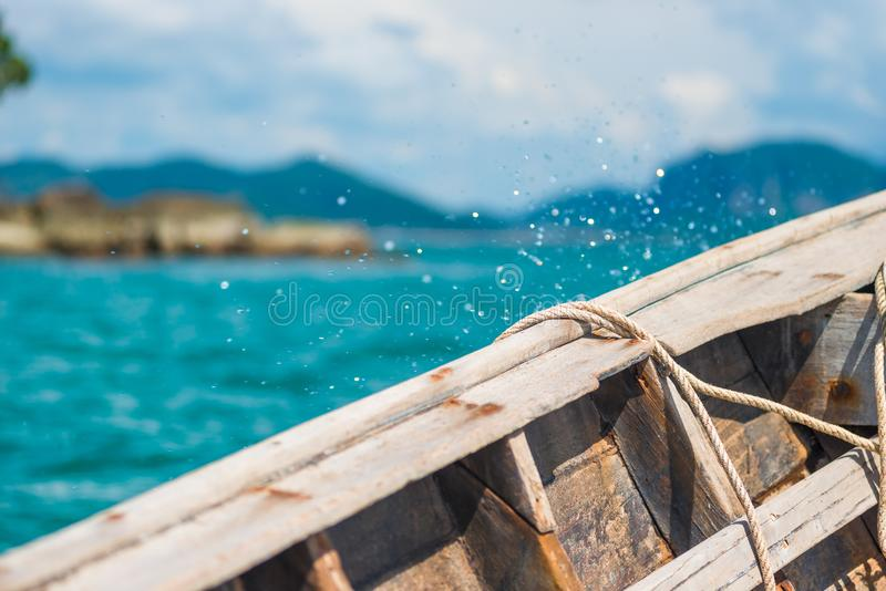 board of a wooden boat close-up and splashing water stock images