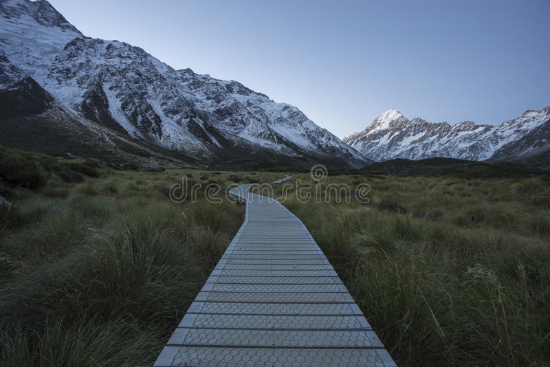 Boarded trail section in Valley on a track leading to Aoraki, Mount Cook royalty free stock photo