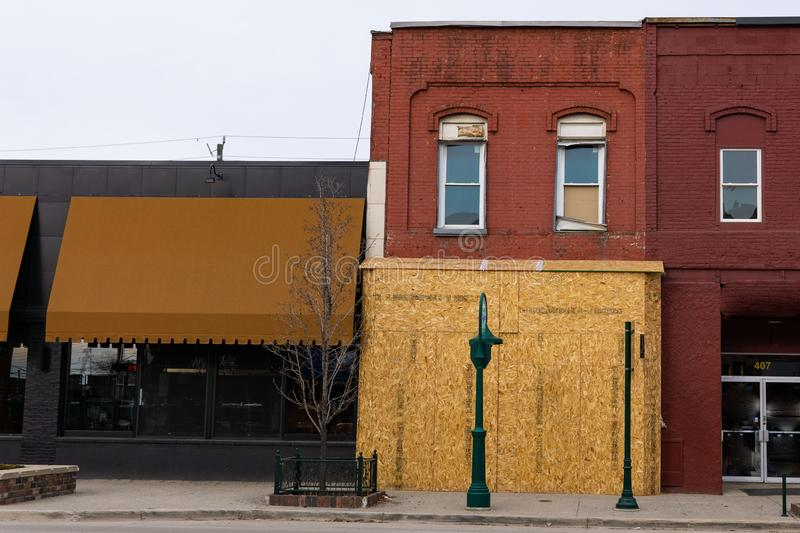 Boarded up building in Rochester, Michigan. Boarded up historic building in the american midwest, Rochester Michigan stock images