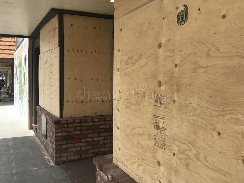 Boarded up windows at a business stock photo