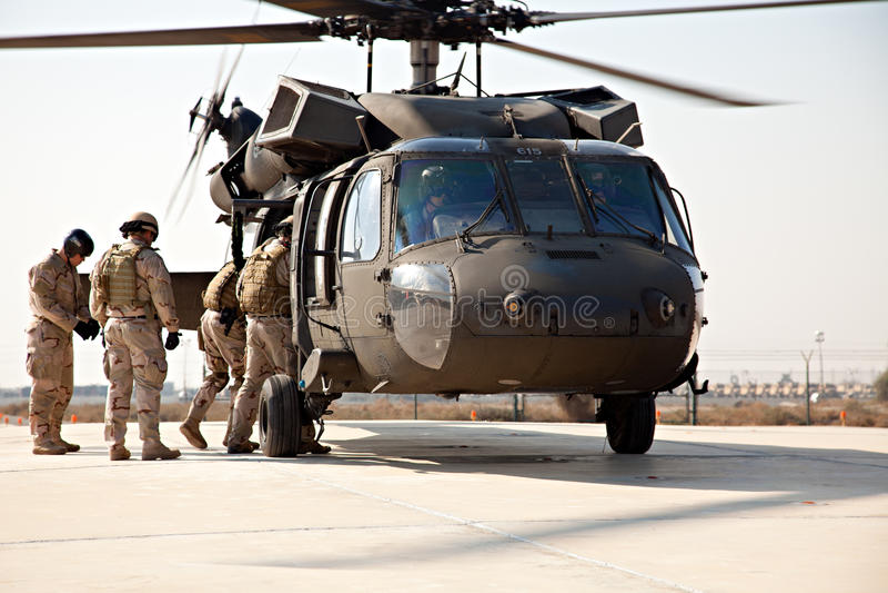 Boarding a Blackhawk SH-60 stock photography