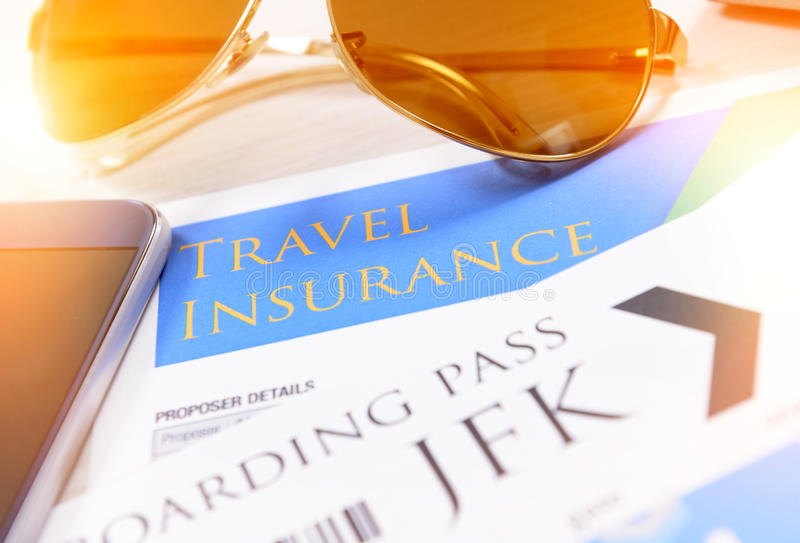 Boarding pass tickets and travel insurance stock photo