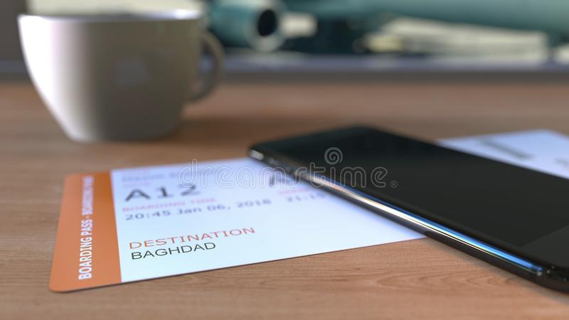 Boarding pass to Baghdad and smartphone on the table in airport while travelling to Iraq. 3D rendering. Boarding pass to Baghdad and smartphone on the table in stock photo
