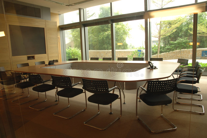 Boardroom. With display screen and video conference equipment