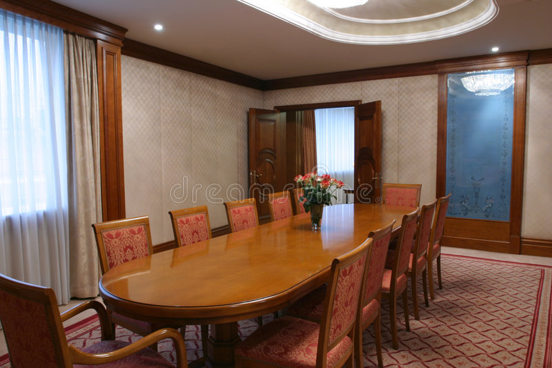 Boardroom. Ready for business meeting with long wooden table and rose bouquet royalty free stock photo
