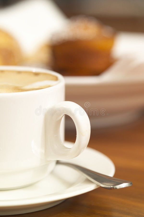 Boardroom drink. A stack of croissant and a fresh cup of coffee royalty free stock photography