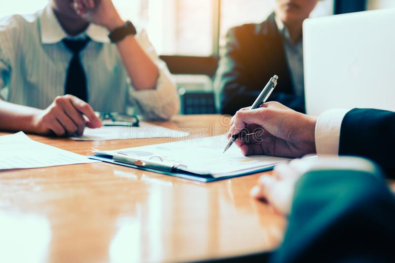Boardroom with human resource business people writing on paper with sign a contract.  stock photo
