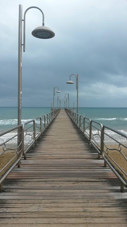 Boardwalk across beach royalty free stock photography