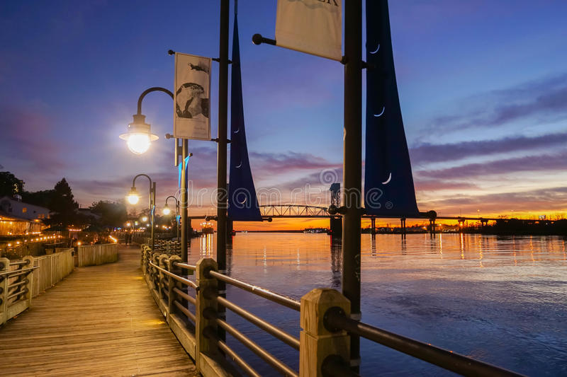 Boardwalk along Cape Fear River after sunset royalty free stock photo