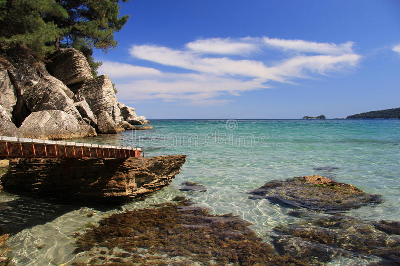 Boardwalk at bay on Thassos stock images