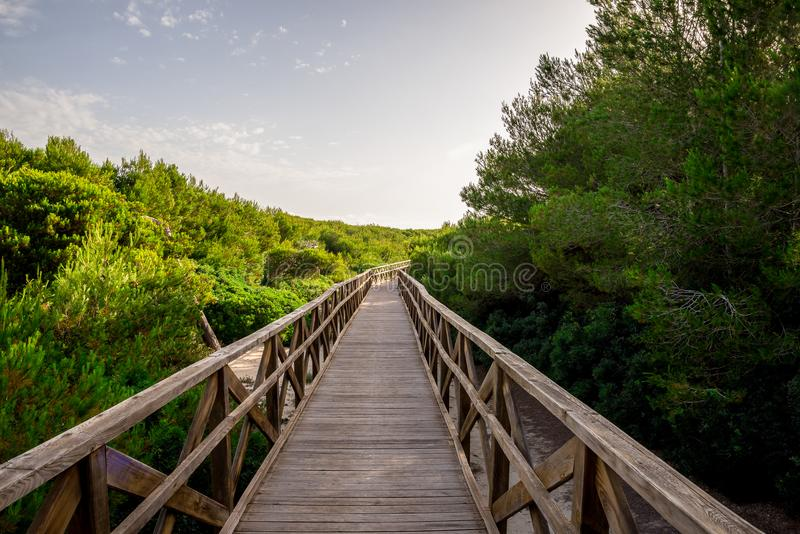A boardwalk bridge to Playa de Muro beach in Can Picafort, Mallorca stock photography