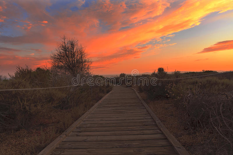 Boardwalk at Crystal Cove beach at sunset. Boardwalk at Crystal Cove beach in California at sunset in the summer royalty free stock photos