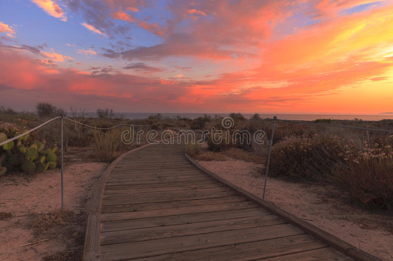 Boardwalk at Crystal Cove beach at sunset. Boardwalk at Crystal Cove beach in California at sunset in the summer stock photography