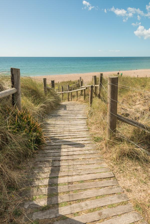 Boardwalk leading to the beach in the seaside town of Littlehampton UK. Boardwalk leading to the beach. Image taken in the seaside town of Littlehampton, West stock photo