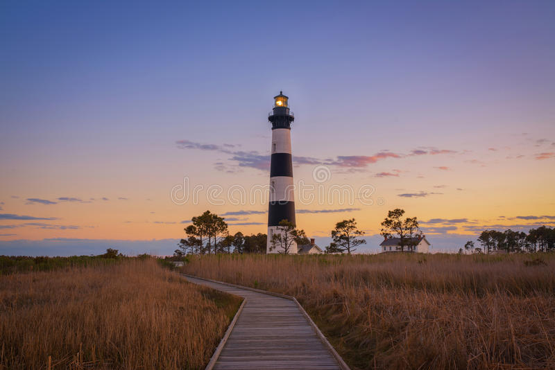 Boardwalk leading to Bodie Island Light. A beautiful sunset at Bodie Island Lighthouse in Nags Head royalty free stock image