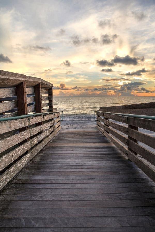 Boardwalk leading to the ocean at Vanderbilt Beach at sunset. In Naples, Florida stock photos