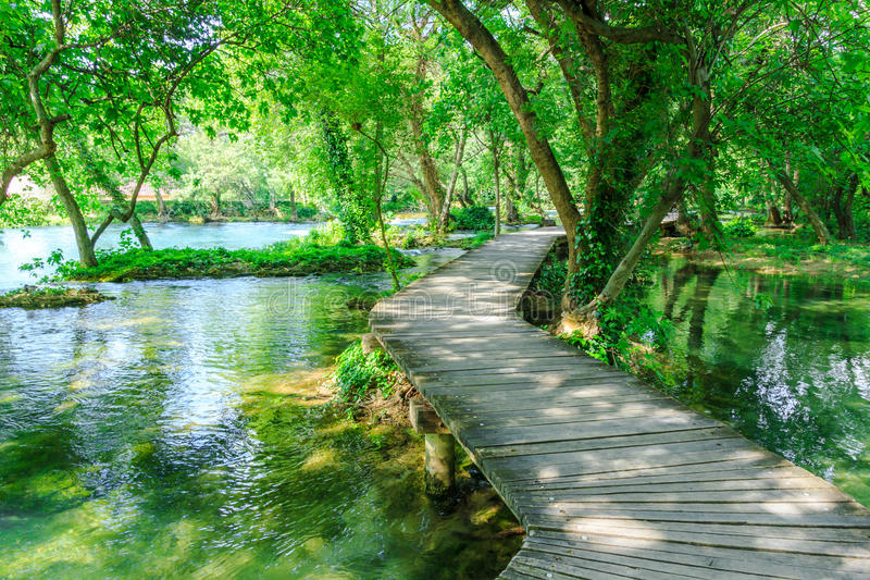 Boardwalk over clear freshwater pools at Krka national park Croatia royalty free stock image