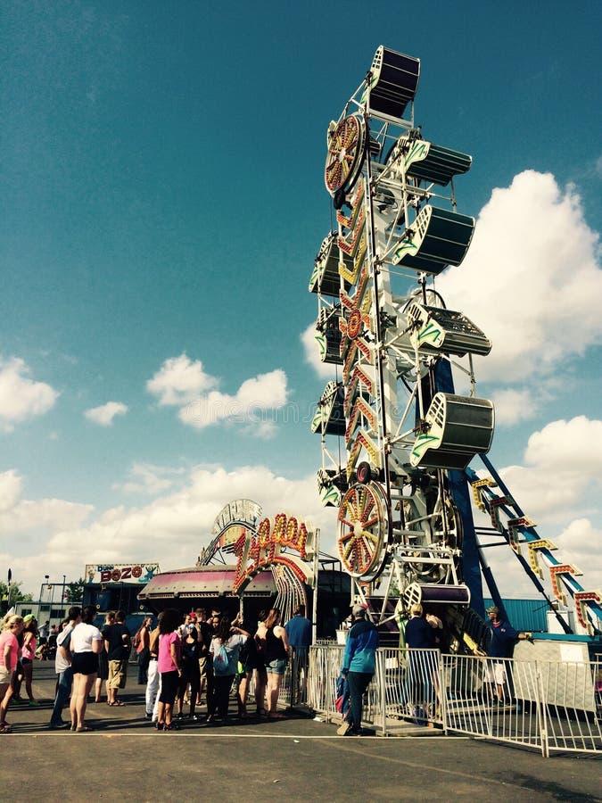 Boardwalk. Roar coaster fair along the shore stock image