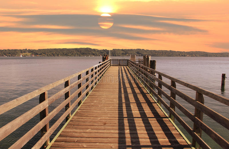 Boardwalk at starnberger see, sunset mood royalty free stock images