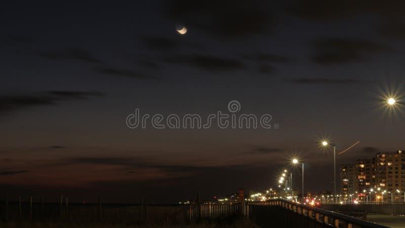 Boardwalk after sunset stock images