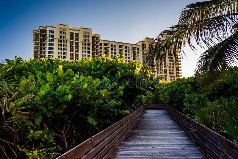 Boardwalk trail and hotel on Singer Island, Florida. stock photo