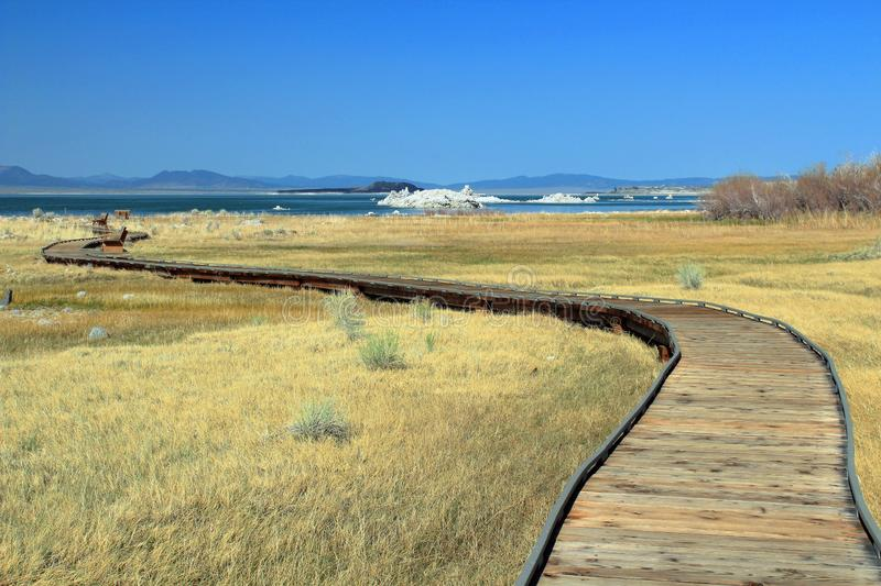 California, USA, Boardwalk and Tufa Formations at Mono Lake Tufa State Natural Reserve. The Tufa deposits on the shores of Mono Lake are accessible by a windy royalty free stock photography